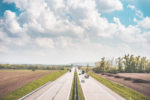 european-highway-surrounded-by-fields-picjumbo-com